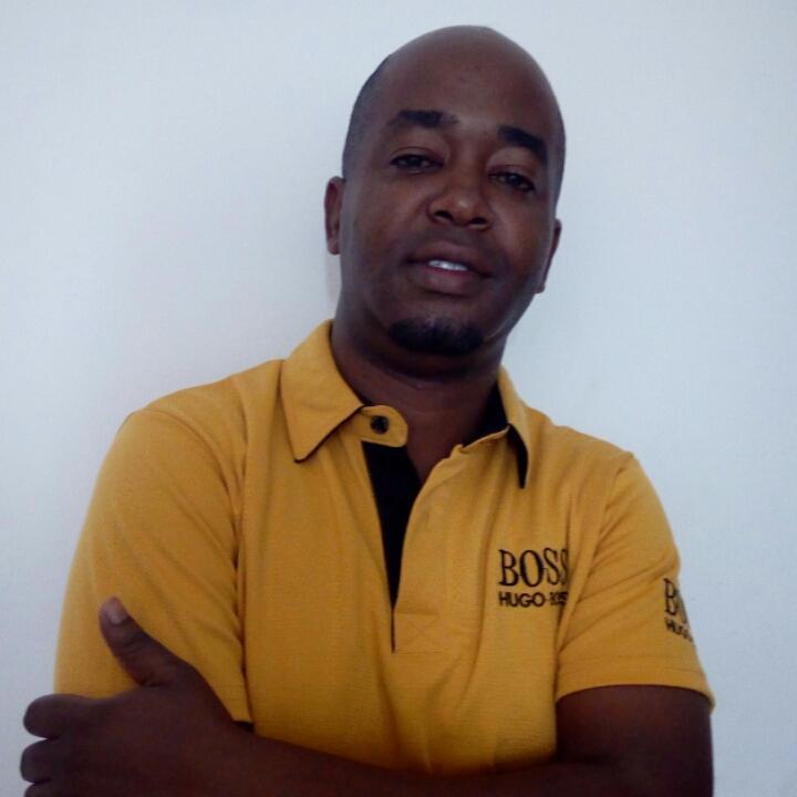Mr. John Kiandika from Tanzania - The 1st winner of Xmas Car Giveaway 2016