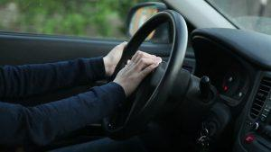 Positioning hands when driving car