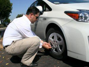 Drivers checking his car