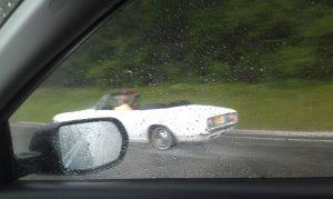 car rushing in the rain