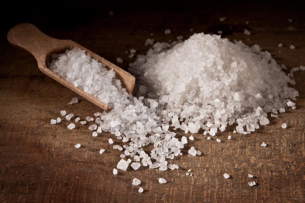 Using salt to melt ice on car