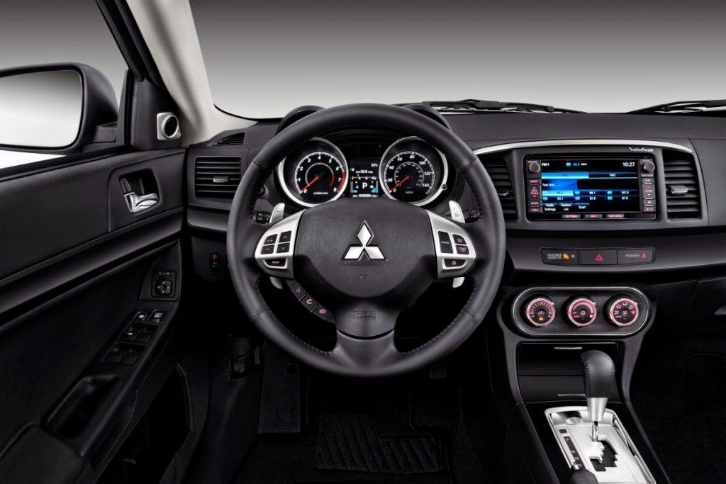 Interior of 2015 Mitsubishi Lancer looks quite cheap.