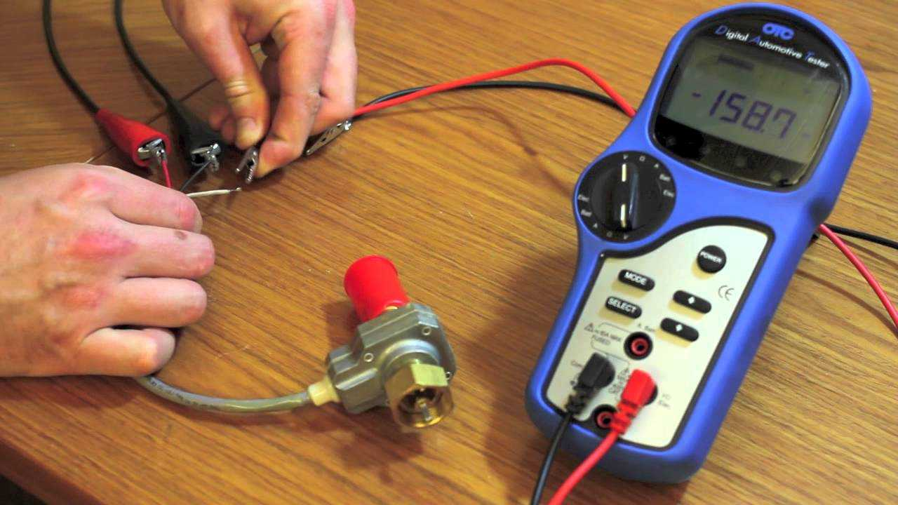 Probes in the voltmeter are attached to the terminal of the sensor