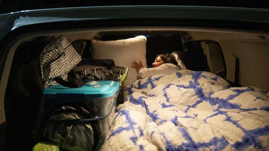 For a large car, it's easy for you to set the back seats into a bed. (Source: deseret)