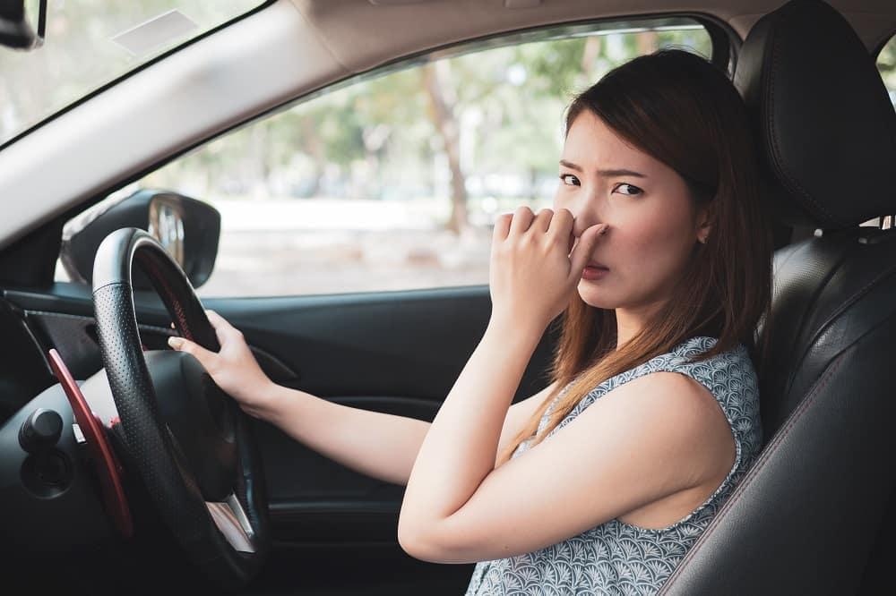 smelly exhaust reasons
